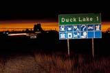 SIG MIS MIS  SK   WS21815D   DUCK LAKE TOWN SIGNDUCK LAKE                         12/..© WAYNE SHIELS                ALL RIGHTS RESERVEDDUCK_LAKE;HIGHWAYS;PLAINS;PRAIRIES;ROAD;SASKATCHEWAN;SIGNS;SK_;TOWNS;WINTERLONE PINE PHOTO              (306) 683-0889