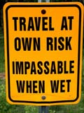 SIG MIS MIS  SK  CWN02D0420D  VTTRAVEL AT OWN RISK, IMPASSABLE WHEN WET SIGNTHE GAPCYPRESS HILLS                         07/03© CLARENCE W. NORRIS           ALL RIGHTS RESERVEDCYPRESS_HILLS;DANGER;PLAINS;PLATEAU;PRAIRIES;ROAD;SASKATCHEWAN;SIGNS;SK_;SUMMER;THE_GAP;TRAVEL;VTLLONE PINE PHOTO                  (306) 683-0889