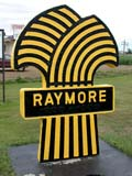 SIG MIS MIS  SK  CWN02D1624D  RAYMORE SIGNRAYMORE                               0730© CLARENCE W NORRIS           ALL RIGHTS RESERVEDPLAINS;PRAIRIES;RAYMORE;SASKATCHEWAN;SIGNS;SK_;SPRING;TOWNS;VTL;WHEATLONE PINE PHOTO                  (306) 683-0889.