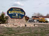 SIG MIS MIS  SK  CWN0357898DTOWN OF MARTENSVILLE ENTRANCE SIGN, SHELL STATION AND GRAVEL TRUCK BEHINDMARTENSVILLE                    053© CLARENCE W. NORRIS      ALL RIGHTS RESERVEDAUTOS;MARTENSVILLE;PLAINS;PRAIRIES;SASKATCHEWAN;SIGNS;SK_;SUMMER;TOWNS;WELCOMELONE PINE PHOTO              (306) 683-0889