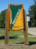 SIG MIS MIS  SK  LJN05A0679DX  VTPREECEVILLE TOWN SIGNPREECEVILLE                       0730© LAURA NORRIS                ALL RIGHTS RESERVEDGEOMETRY;PLAINS;PRAIRIES;PREECEVILLE;SASKATCHEWAN;SIGNS;SK_;SUMMER;TOWNS;VTLLONE PINE PHOTO              (306) 683-0889