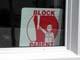 BLOCK PARENT SIGN IN WHITE WINDOW, CLOSE-UP, SASKATOON