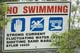 NO SWIMMING SIGN AT WEIR, SASKATOON