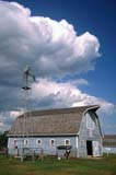 STR BAR MIS  SK     2006329D  VTWINDMILL, GREY BARN AND CLOUDSSEAGER WHEELER'S MAPLE GROVE FARM NATIONAL HISTORIC SITEROSTHERN                           083© CLARENCE W. NORRIS       ALL RIGHTS RESERVEDARCHITECTURE;BARNS;BUILDINGS;BULLETINS;CLOUDS;HISTORIC;FARMING;FARMYARDS;PLAINS;PRAIRIES;ROSTHERN;RURAL;SASKATCHEWAN;SCENES;SEAGER_WHEELERS_FARM_NHS;SK_;SKY;STRUCTURES;SUMMER;VTL;WINDMILLSLONE PINE PHOTO               (306) 683-0889