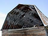 STR BAR MIS  SK  CWN02D0751DPATTERNS ON BEAMS OF OLD BARN ROOFSTEWART VALLEY                    07/02© CLARENCE W.  NORRIS          ALL RIGHTS RESERVEDARCHITECTURE;BARNS;BUILDINGS;FARMING;PATTERNS;PLAINS;PRAIRIES;ROOFS;RURAL;SASKATCHEWAN;SK_;STEWART_VALLEY;STRUCTURES;SUMMER;WOODLONE PINE PHOTO                   (306) 683-0889