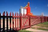 STR ELE PIO  SK     1905608D  PIONEER GRAIN ELEVATOR AND PICKET FENCEGLASLYN                                 06. .© CLARENCE W NORRIS           ALL RIGHTS RESERVEDBUILDINGS;ELEVATORS;FARMING;FENCES;GATES;GEOMETRY;GLASLYN;PIONEER;PLAINS;PRAIRIES;RURAL;SASKATCHEWAN;SCENES;SK_;SUMMER;STRUCTURES;TOWNSLONE PINE PHOTO                  (306) 683-0889.