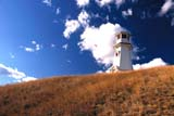 STR LIG MIS  SK     1413215DLIGHTHOUSE ON HILLTOP IN AUTUMN BLUE SKY AND CLOUDS JACKFISH LAKECOCHIN                               108© CLARENCE W. NORRIS        ALL RIGHTS RESERVEDAUTUMN;COCHIN;JACKFISH_LAKE;LIGHTHOUSES;PLAINS;PRAIRIES;SASKATCHEWAN;SCENES;SK_;SKY;STRUCTURESLONE PINE PHOTO                (306) 683-0889