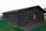 STR SOD HOU  AB  KJM0302617DRESTORED SOD HOUSEMORRIN                             05/..© KEVIN MORRIS                ALL RIGHTS RESERVEDAB_;ALBERTA;BUILDINGS;HISTORIC;HOMES;MORRIN;PIONEERS;PLAINS;PRAIRIES;SHELTERS;SOD;SOD_HOUSES;STRUCTURES;SUMMER LONE PINE PHOTO              (306) 683-0889