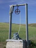 STR WEL MIS  SK  CWN02D3401D  VT           WATER WELL AND GREEN SUMMER FIELDST. DENIS                              09/. .© CLARENCE W. NORRIS          ALL RIGHTS RESERVEDBULLETINS;FARMING;FIELDS;PIONEERS;PLAINS;PRAIRIES;PULLEYS;ROPES;RURAL;SASKATCHEWAN;SCENES;SK_;STRUCTURES;ST_DENIS;SUMMER;VTL;WATER;WELLSLONE PINE PHOTO                  (306) 683-0889