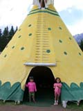 STR TEE MIS  AB  CWN02D2230D  NMR  VTTWO ASIAN GIRLS IN FRONT OF TEEPEECANADA PLACEBANFF                                      08..© CLARENCE W. NORRIS           ALL RIGHTS RESERVEDAB_;ABORIGINAL;ALBERTA;ALPINE;ASIAN;BANFF;CANADA_PLACE;CHILDREN;CORDILLERA;CULTURE;FIRST;FIRST_NATIONS;GIRL;NATIONS;PEOPLE;SHELTERS;STRUCTURES;SUMMER;TEEPEES;VTLLONE PINE PHOTO                  (306) 683-0889