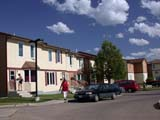 STR URB MIS  SK  CWN03D5511D   LOW-INCOME TOWNHOUSESSASKATOON                       072© CLARENCE W. NORRIS      ALL RIGHTS RESERVEDAUTOS;BUILDINGS;HOMES;MULTI_UNIT_DWELLINGS;PEOPLE;PLAINS;PRAIRIES;SASKATCHEWAN;SASKATOON;SK_;STREETS;STRUCTURES;TOWNHOUSES;URBANLONE PINE PHOTO              (306) 683-0889