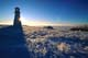 SUNSTAR BEHIND LIGHTHOUSE IN WINTER, JACKFISH LAKE, COCHIN