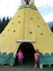 TWO ASIAN GIRLS IN FRONT OF TEEPEE, CANADA PLACE, BANFF